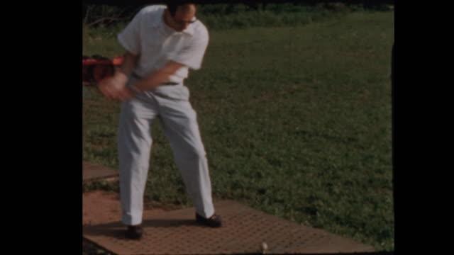 Man tees off at Golf Driving Range