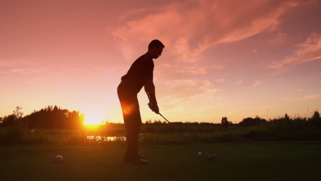 Man tees off at sunrise video