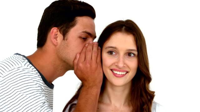 Man telling secret to surprised woman video