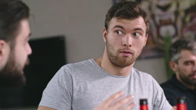 Man Telling Shocking Story to Friend - vídeo
