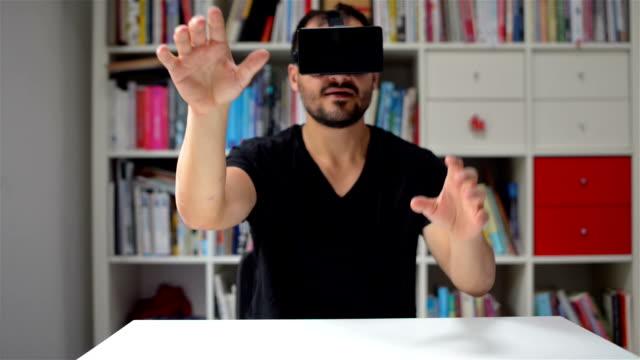 DOLLY SHOT: Man testing VR glasses video