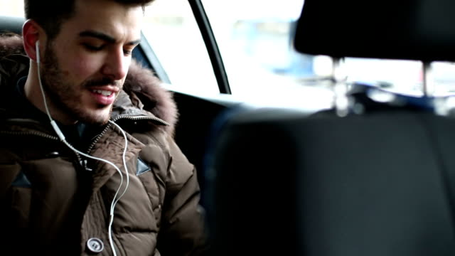 Man text messaging in the car video