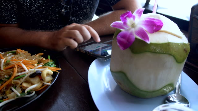 Man Texting on Phone in Asian Restaurant video