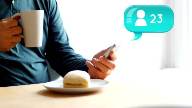 Man texting while having breakfast 4k