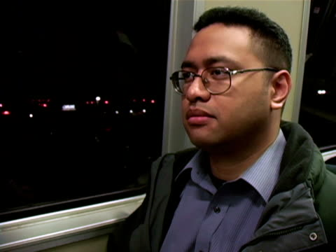man thinking on train video