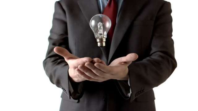 stockvideo's en b-roll-footage met man throwing a light bulb - overhemd en stropdas