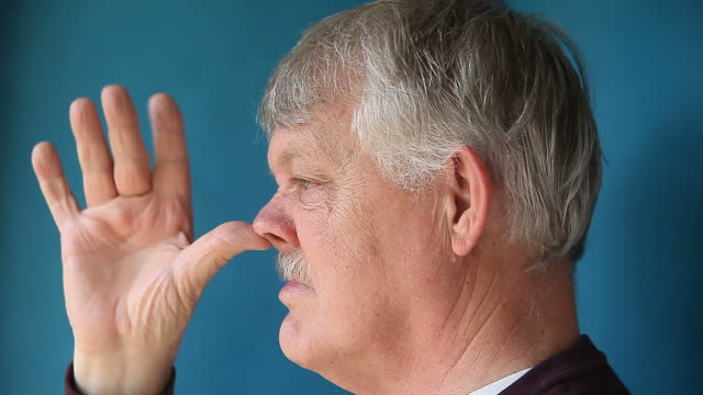 Man Thumbing Nose
