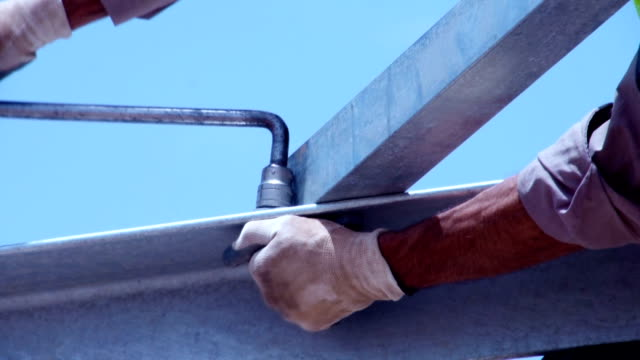 Man tightening a bolt or screw using a socket video