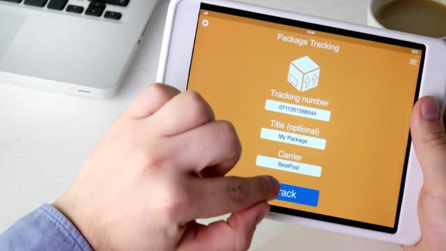Man tracks his package using digital tablet application