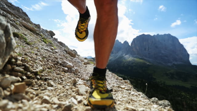 Man trail running on Dolomites high mountain Man trail running on Dolomites high mountain athleticism stock videos & royalty-free footage