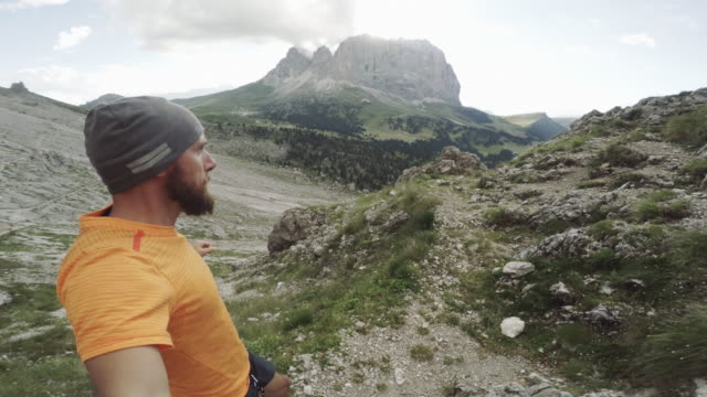POV Man trail running on mountain ridge video