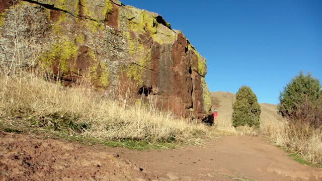 man trail runs red rocks park morrison colorado rocky mountains - red rock video stock e b–roll