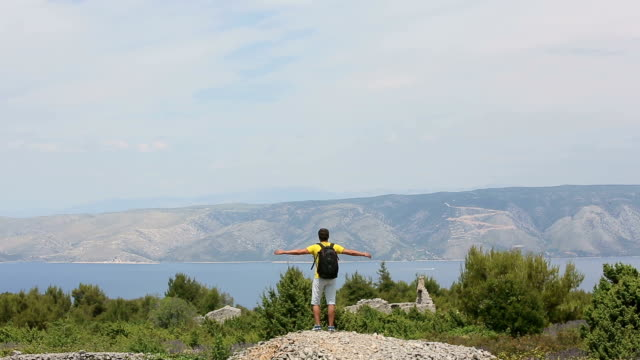Man traveler on a mountain top video