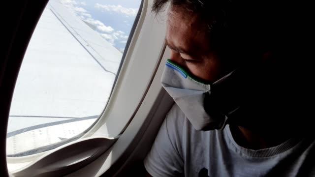 Man traveling by plane during coronavirus epidemic