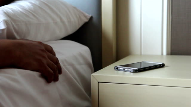 Man try to wakes up in the morning with calling from smart phone video