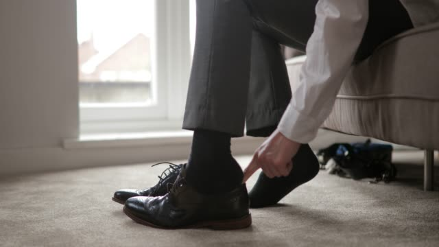 Man Tying Shoe Laces video