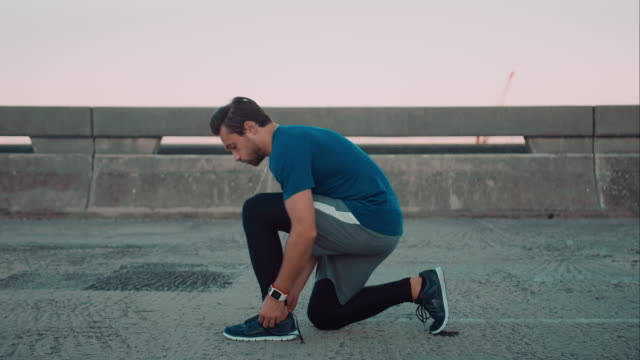 Man tying shoes video