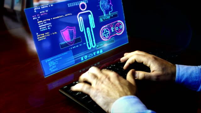 vídeos de stock e filmes b-roll de man typing keyboard with game creating hologram screen - liga desportiva