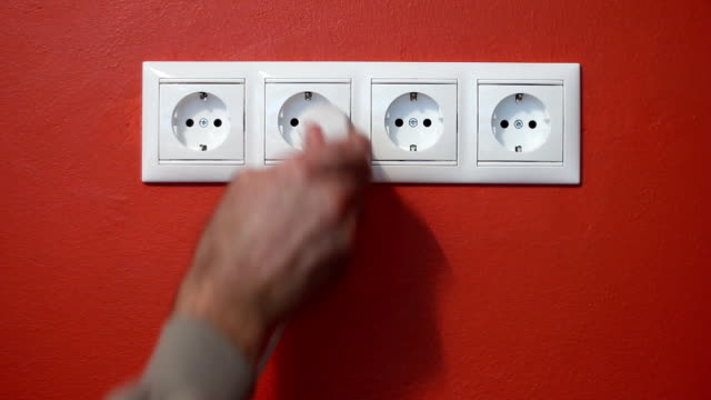 Man unplug and push electric plug into the socket video