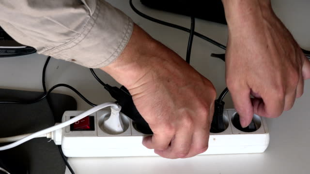 Man unplugging electrical plugs video