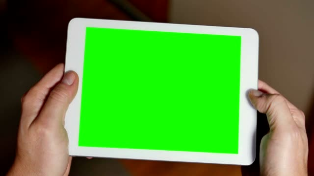 Man Uses Blank Green Screen Tablet PC to Play a Game video
