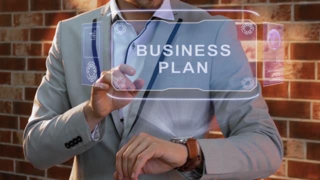 Man uses smartwatch hologram Business plan