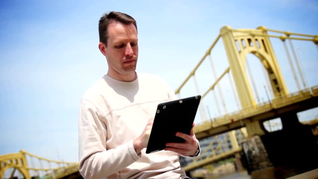 Man Uses Tablet PC Outside video