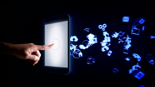 Man using a digital tablet with icons flying from it.
