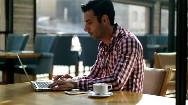 Man using a laptop video