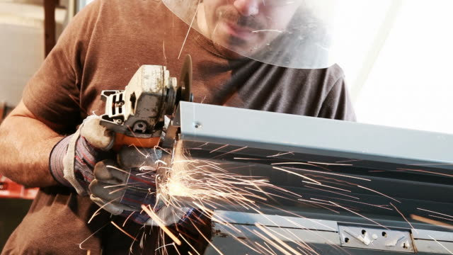 Man Using an Angle Grinder video