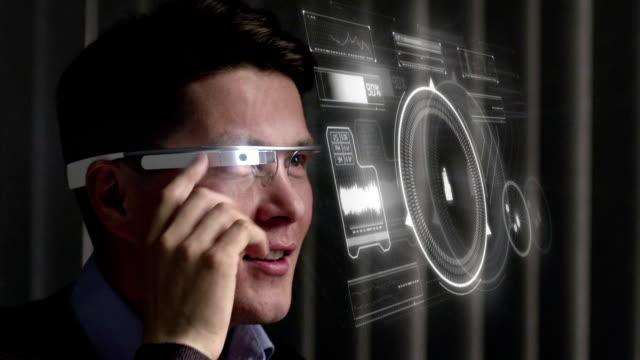 man using augmented reality specs - голографический стоковые видео и кадры b-roll