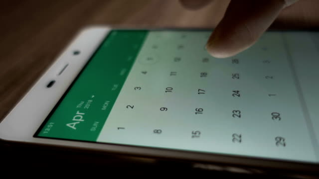 Man using calendar app on the mobile device closeup. Close-up male hands scrolling screen on smartphone. Man using calendar app on the mobile device closeup. Close-up male hands scrolling screen on smartphone. personal organizer stock videos & royalty-free footage