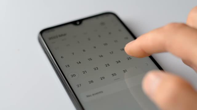 Man using calendar app on the mobile device closeup video