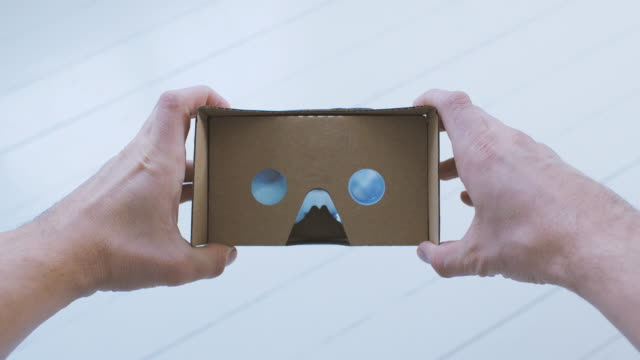 Man using Cardboard Virtual Reality Glasses POV video