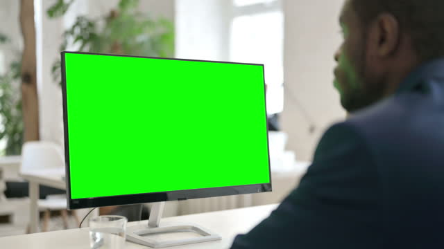 Man Using Desktop with Green Chroma Key Screen Businessman Using Desktop with Green Chroma Key Screen, device screen stock videos & royalty-free footage