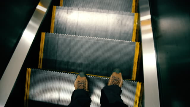 pov man using escalator - subway video stock e b–roll