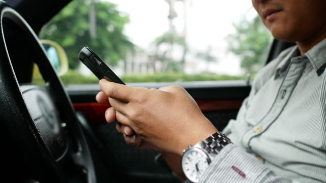 Man Using Gps Navigation In Cellphone While Driving Car video