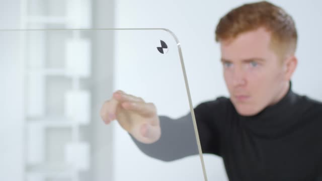 Bидео Man Using Invisible AR Interface