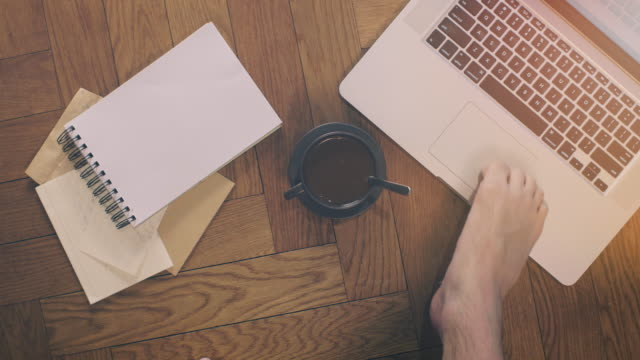 Man using Laptop and Coffee with Feet video