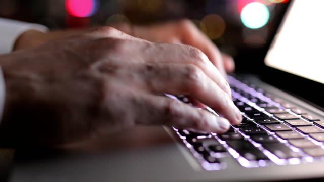 Man using laptop in the night