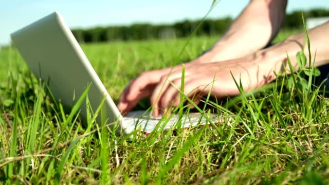 Man using laptop outdoors video