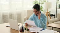 istock Man using mobile phone and reading document 1306073840