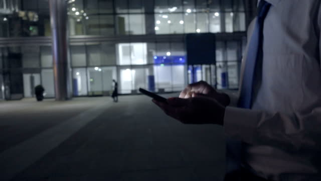 Man using mobile phone at night in the city video