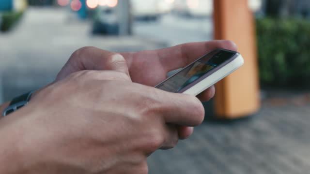 Man using mobile phone video