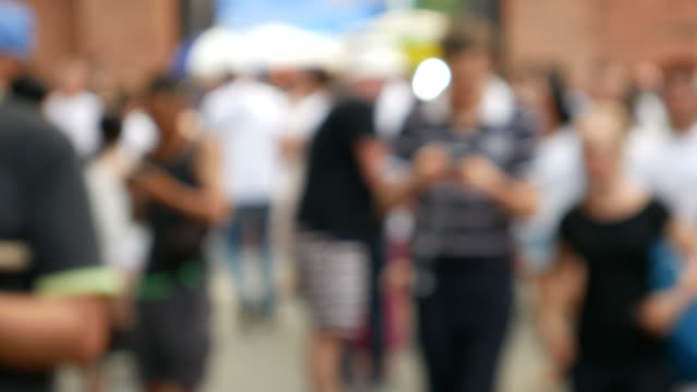 Man using phone at Walking Street, Chiang Mai video