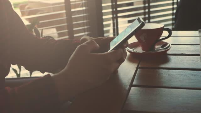 Man using phone in coffee bar stock video