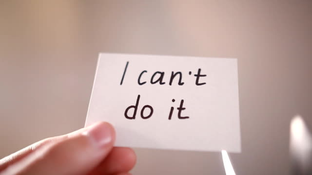 Man using scissors to remove the word can't to read I can do it concept for self belief Man using scissors to remove the word can't to read I can do it concept for self belief, positive attitude and motivation chance stock videos & royalty-free footage