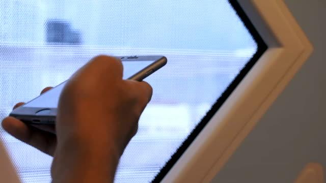 Man Using Smart Phone On A Train video