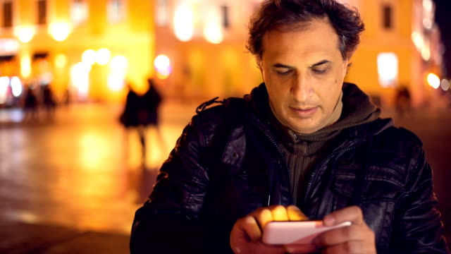 Man using smart phone Man using smart phone. cordless phone stock videos & royalty-free footage