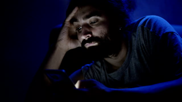Man using smart phone video
